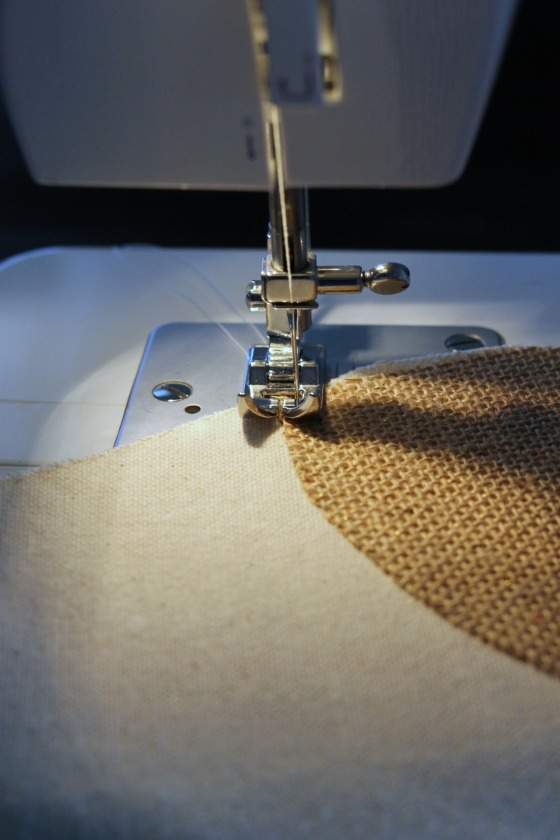 Place the edge of the burlap right in line with the needle.